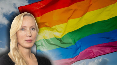 En prideflagga med ett foto av Anna Norling monterat över