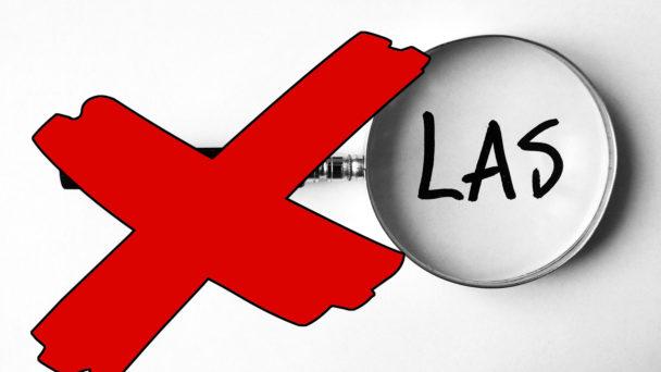 Ett förstoringsglas riktat mot ordet LAS, med ett rött kryss över.