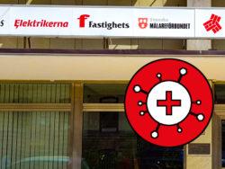 Fasaden på Elektrikernas förbundskontor, med en stiliserad bild av det nya coronaviruset över