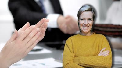 En bild på applåderande mötesdeltagare, med ett foto på skribenten monterat över.