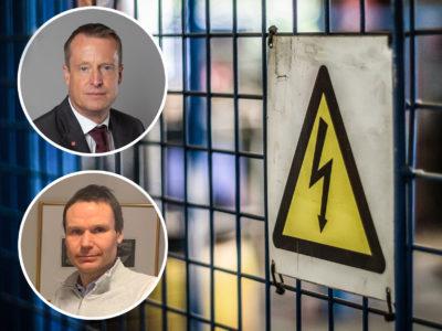 En skylt som varnar för erfara, med porträtt på Anders Ygeman och Petter Johansson monterade över.