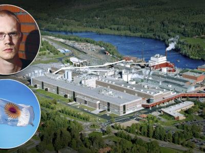 En drönarbild på Kvarnsvedens pappersbruk i Borlänge., med bilder på David Aura och Stora Ensos flagga monterade över